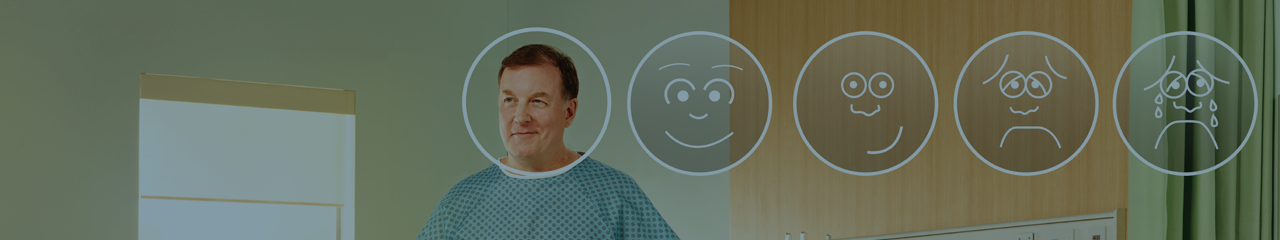 Smiling male postsurgical patient standing in hospital room awaiting discharge